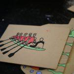 Image of rowers on cardboard
